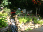 Patio with waterfall and koi pond